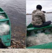 На водоймі піймали чоловіків з сітками